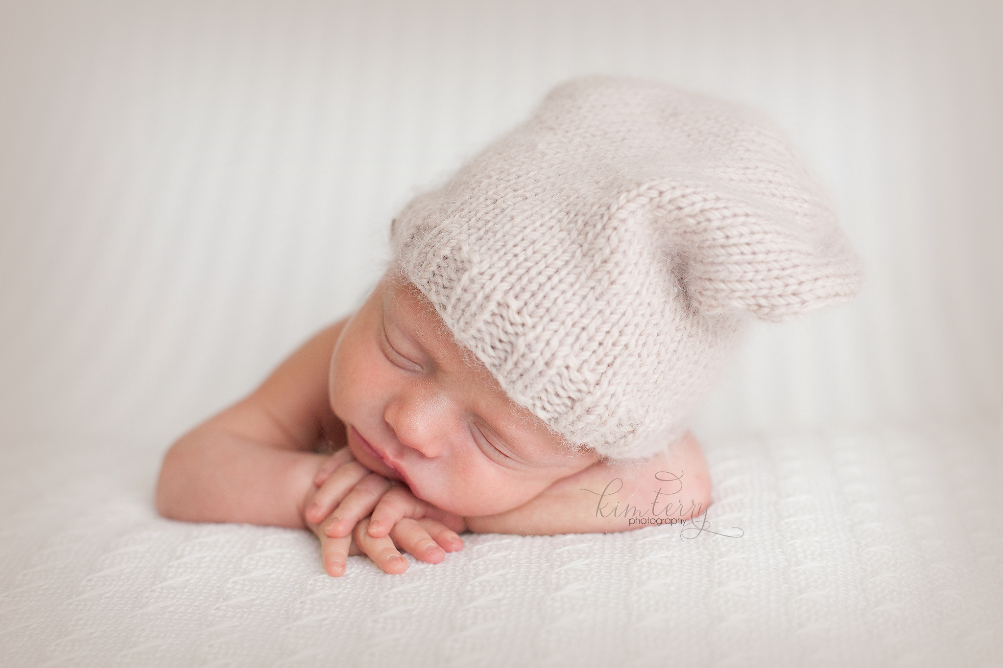 newborn baby with slouchy hat