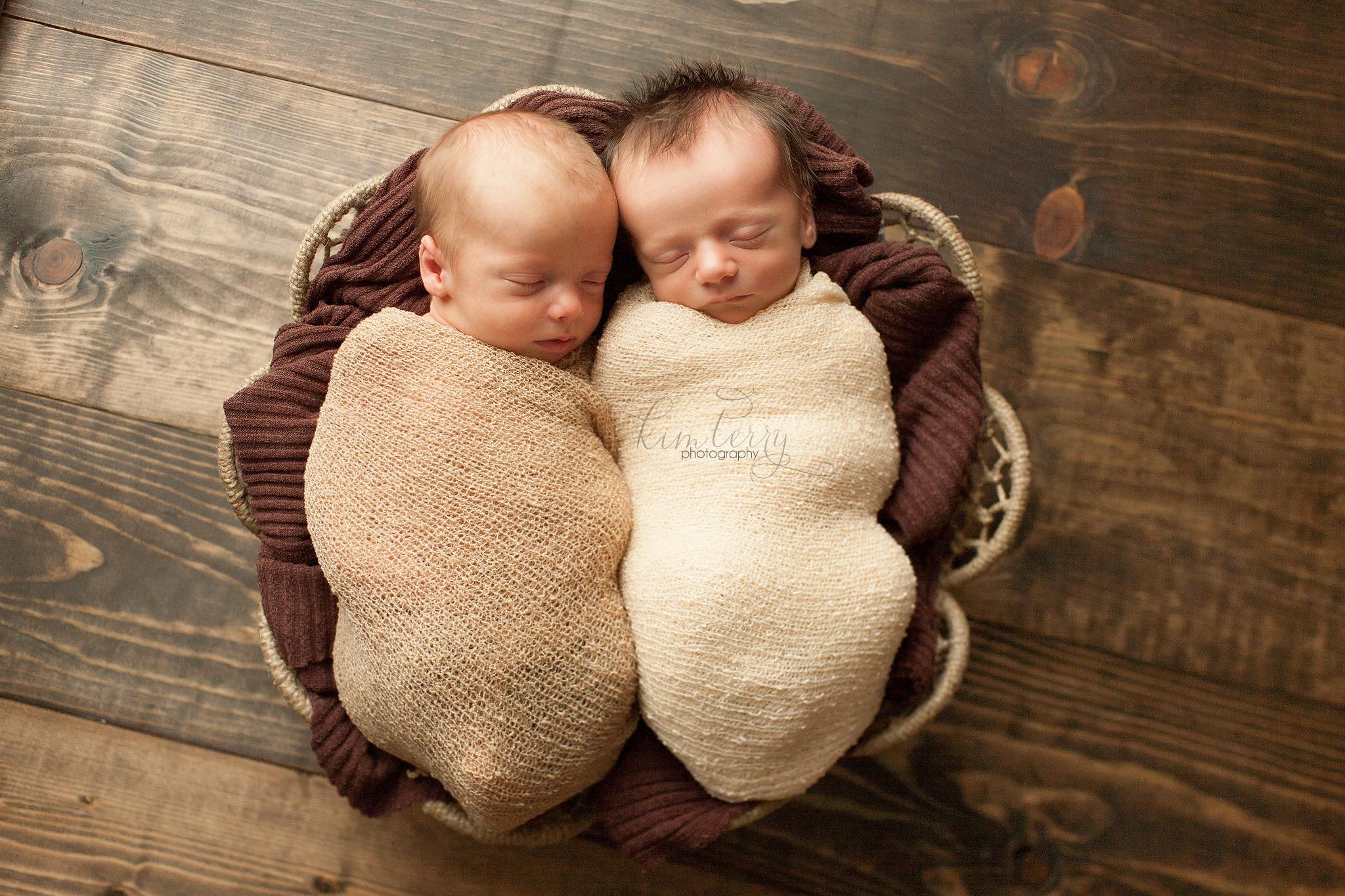 twin newborns wrapped