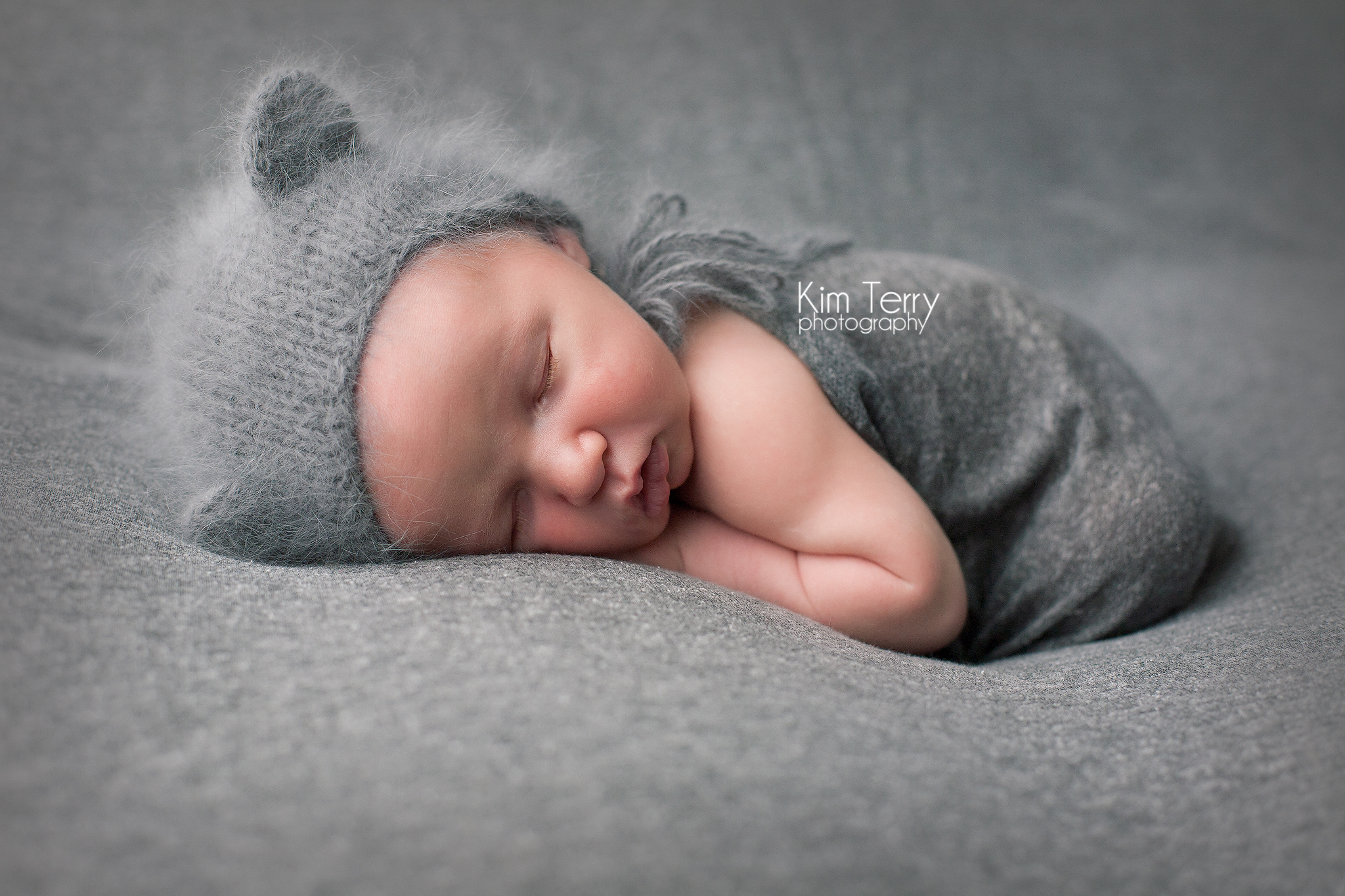 newborn with hat and wrap