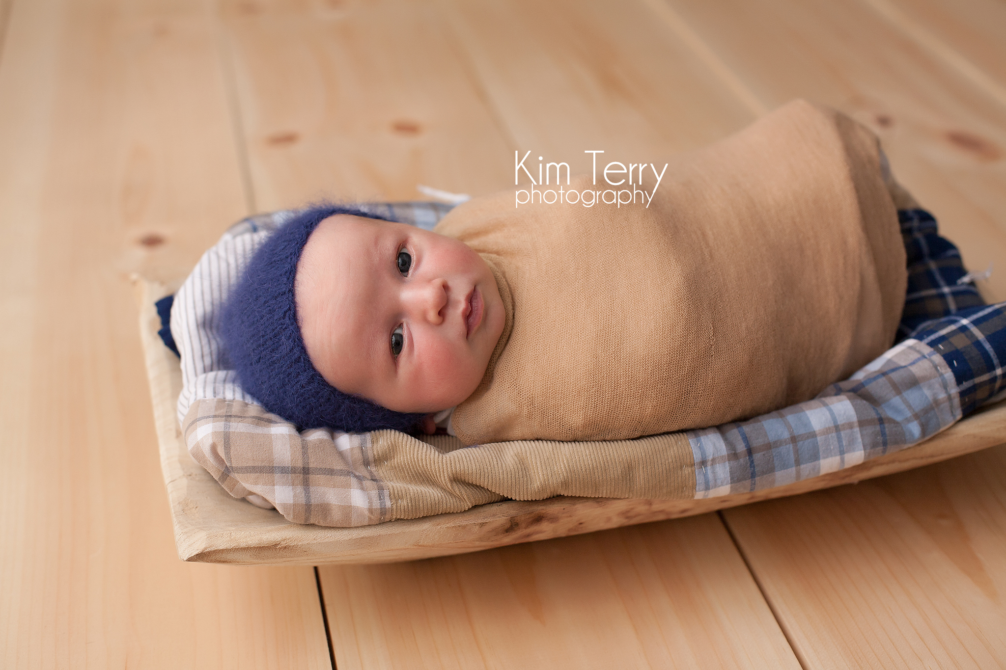 baby on prop wrapped
